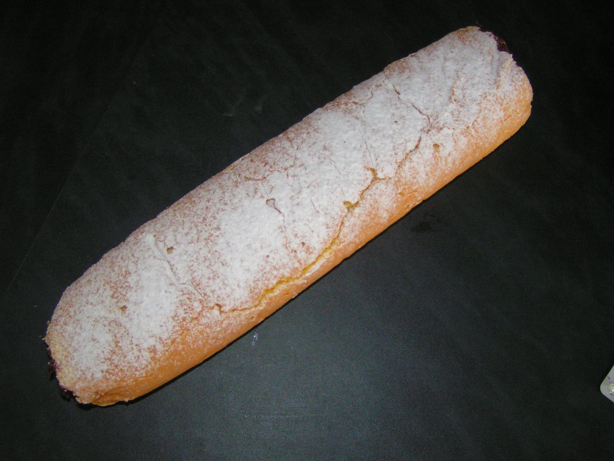 Recept Roláda s marmeládou - Smotaná roláda, pocukrovaná moučkovým cukrem.
